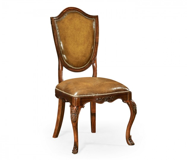 Shield back mahogany side chair with medium antique chestnut leather